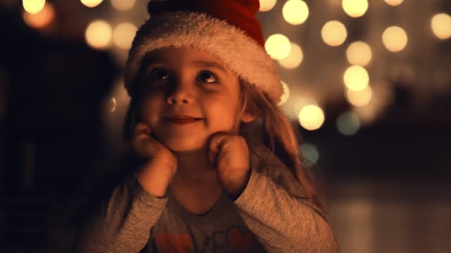 adorable little girl daydreaming about christmas - christmas stock videos & royalty-free footage