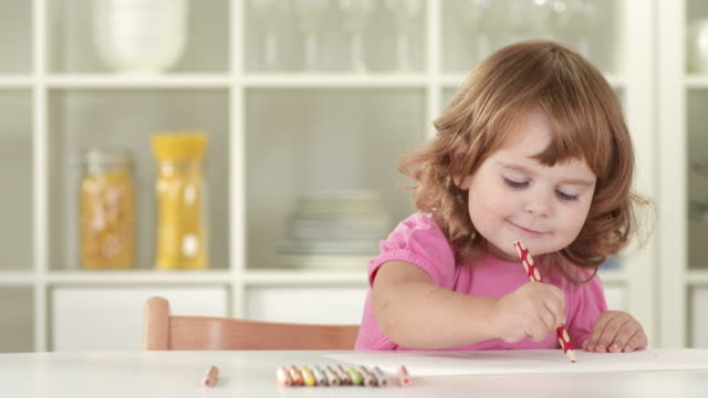 hd: adorable little girl drawing - colored pencil stock videos and b-roll footage