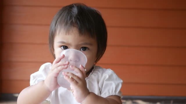 Adorable Little girl drinking water