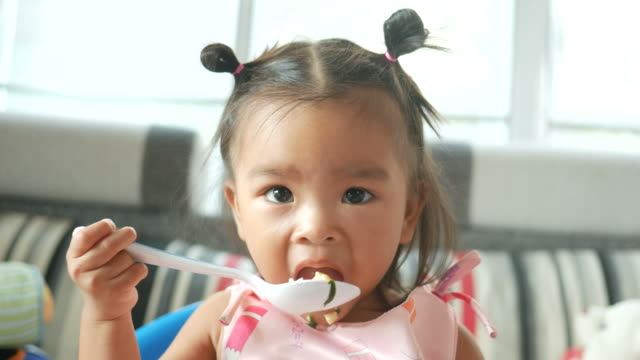 Adorable Little girl Eating Food