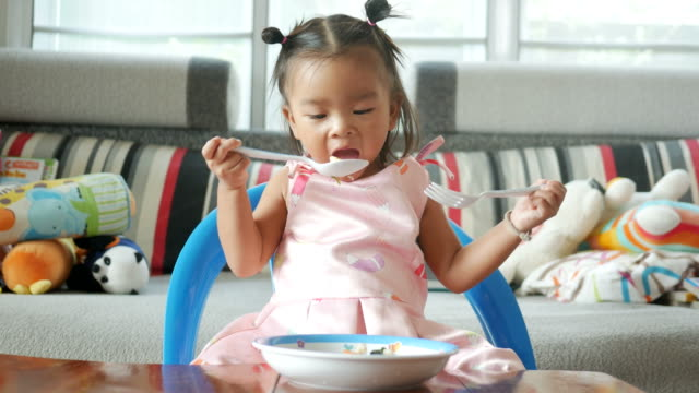 adorable little girl eating food - spoon stock videos & royalty-free footage