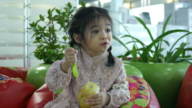 adorable little girl eating fruit - kiwi fruit stock videos and b-roll footage