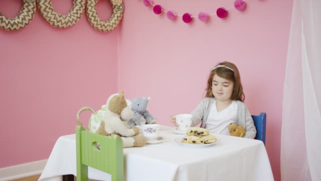 adorable young girl having a tea party with her imaginary friends - tea party stock videos and b-roll footage