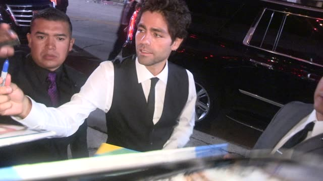 Adrian Grenier takes selfies with fans while departing the After Party for Entourage in Westwood in Celebrity Sightings in Los Angeles