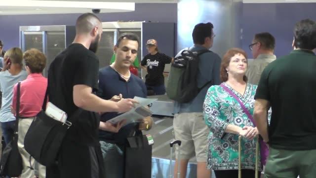vídeos de stock e filmes b-roll de adrian paul greets fans at lax airport on september 20, 2015 in los angeles, california. - adrian paul