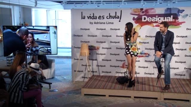 vídeos de stock, filmes e b-roll de adriana lima attends 'la vida es chula' 'life is coll' by desigual new collection - adriana lima