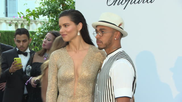vídeos de stock, filmes e b-roll de adriana lima lewis hamilton at amfar gala cannes 2018 on may 17 2018 in cap d'antibes france - adriana lima