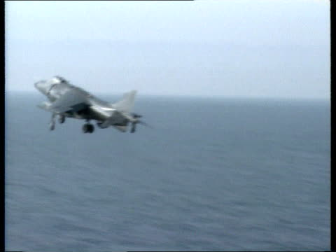 british task force adriatic tcms bow of quothms ark royalquot cutting thru water pull out ms sea king helicopter hovering over deck tlms sea harrier... - wake water stock videos and b-roll footage
