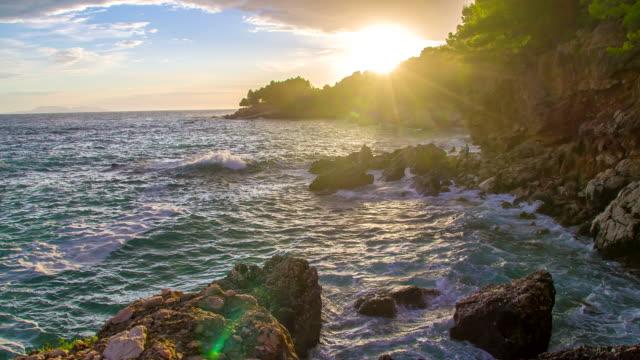 slo mo adriatic coast at sunset - rocky coastline stock videos & royalty-free footage