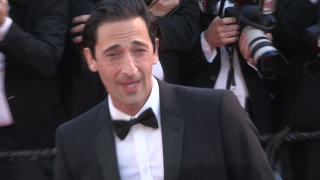 Adrien Brody and girlfriend Lara Lieto on the red carpet of the Opening ceremony of the 70th Cannes Film Festival on May 17 2017 in Cannes France
