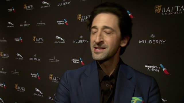 interview adrien brody on being at the event on what makes the bafta tea party one of the most prestigious events of the weekend and on getting ready... - golden globe awards stock videos and b-roll footage