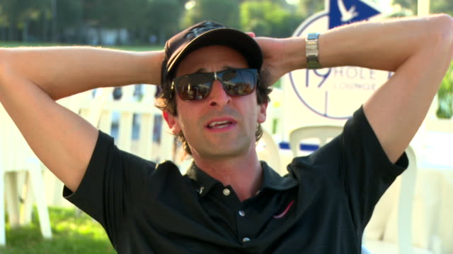 adrien brody talks about how it feels to hang with matt kuchar, says matt is focused yet accessible at grey goose vodka presents tpc uncorked with... - adrien brody stock videos & royalty-free footage