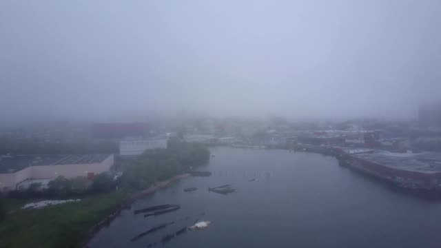 adrone flies over coney island creek during heavy fog in brooklyn new york - vortex stock videos & royalty-free footage