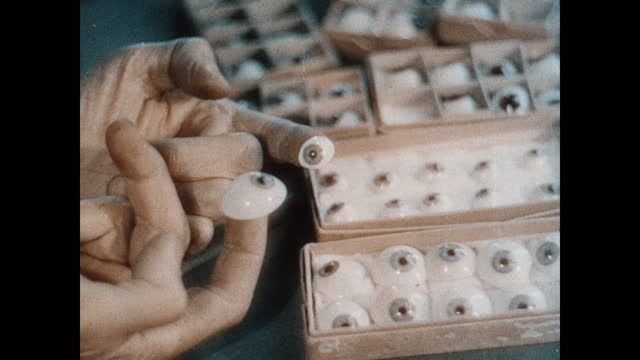 adult caucasian male pointing his finger at different artificial eyes of varying sizes in small cardboard cases. adult caucasian male fingers holding... - eyeball stock videos & royalty-free footage