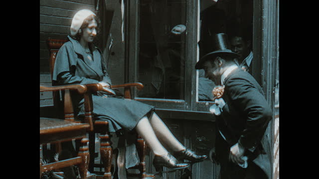 adult caucasian man wearing top hat, suit and monocle, tipping his hat to an adult caucasian woman; she takes a seat in the shoe shine chair. the man... - top hat stock videos & royalty-free footage