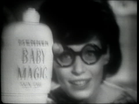adult caucasian woman places baby magic lotion on lens of eyeglasses, and other leading brand on other lens; places glasses in tub of water; baby... - cosmetics stock videos & royalty-free footage