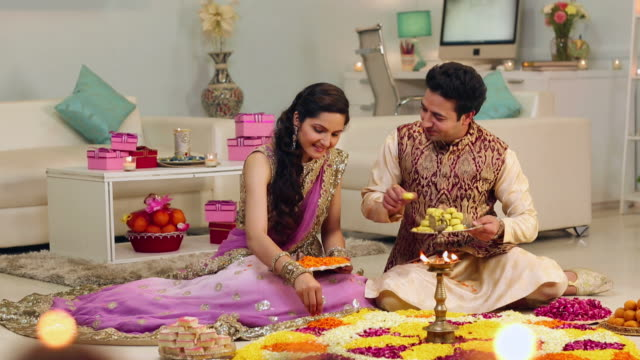 adult couple celebrating diwali festival - sweet food stock videos & royalty-free footage