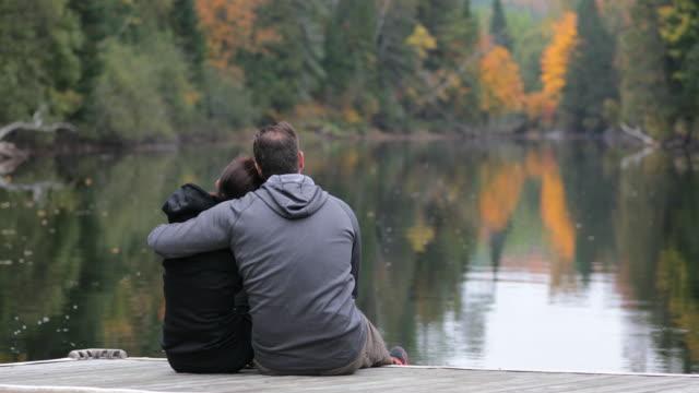 Adult Couple Having Fun On Wooden Dock In Autumn