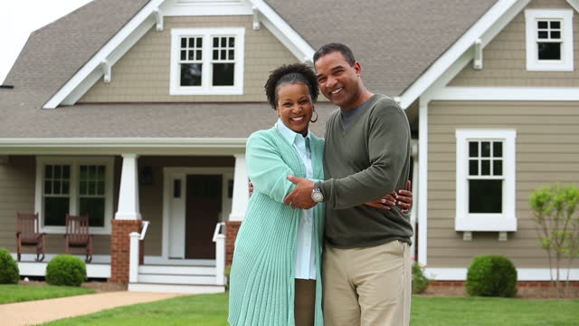 adult couple in front of suburban home - middle class stock videos & royalty-free footage