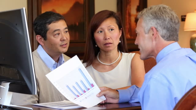 MS Adult Couple Speaking to Financial Advisor, Looking at Charts / Richmond, Virginia, USA
