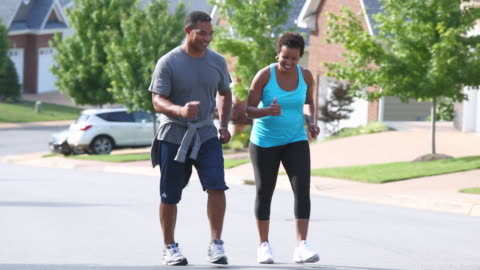 ws ts adult couple walking for exercise in neighborhood / richmond, virginia, usa - husband stock videos & royalty-free footage