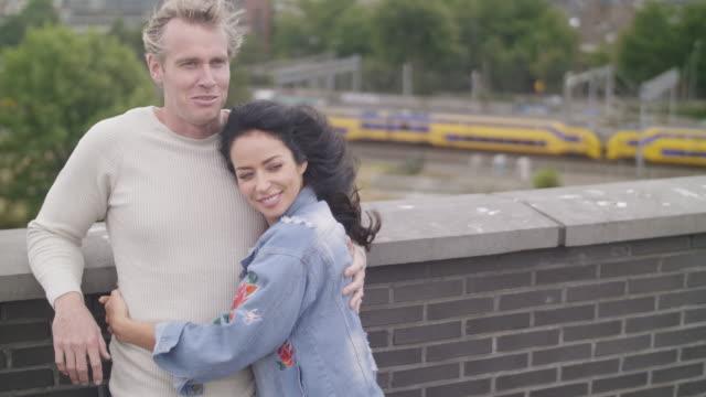 adult dutch couple at rooftop - coppia di adulti di mezza età video stock e b–roll