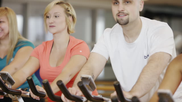 adult exercise bike class - fatcamera stock videos and b-roll footage