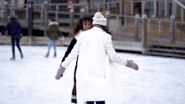 adult female couple ice skating - winter sport stock videos & royalty-free footage