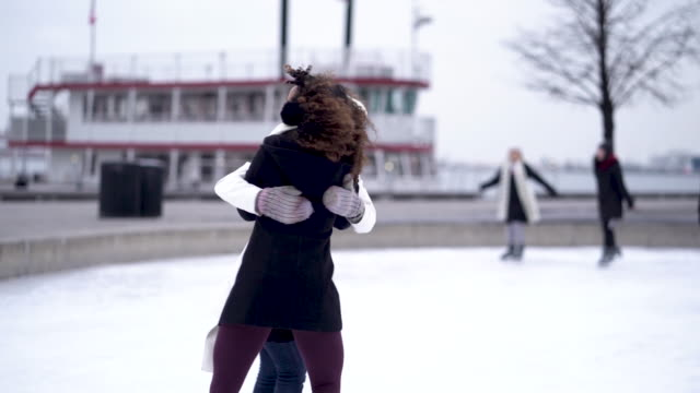adult female couple ice skating - ice skating stock videos & royalty-free footage
