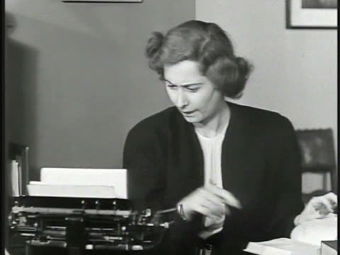 vídeos de stock e filmes b-roll de adult female, executive assistant, secretary, typing on typewriter at desk, looking up something in book. adult male in suit approaching desk, female... - trabalhadora de colarinho branco