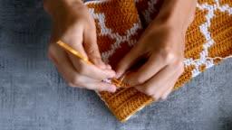 adult girls hands crochet hook