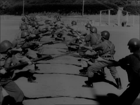 adult korean male rok soldiers in training troops climb over dirt wall crawl on stomachs through barbed wire course with live ammunition adult... - infantry stock videos & royalty-free footage