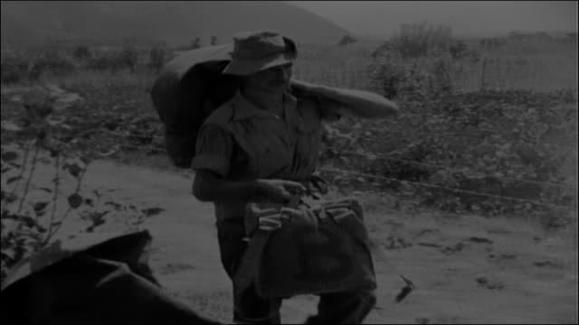 adult male caucasian australian imperial force soldiers wearing traditional slouch hats, unload bags from cargo truck. two young adult male... - world war ii stock videos & royalty-free footage