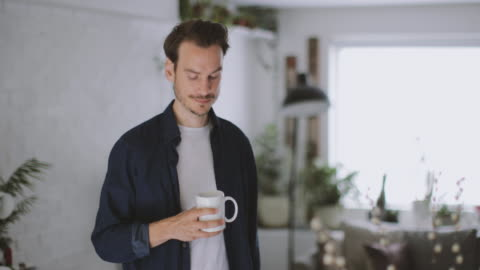 adult male having morning coffee in kitchen - day in the life series stock videos & royalty-free footage