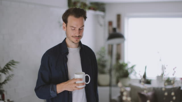 adult male having morning coffee in kitchen - mug stock videos and b-roll footage