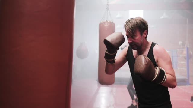 adult male in a boxing fitness class - male likeness stock videos & royalty-free footage