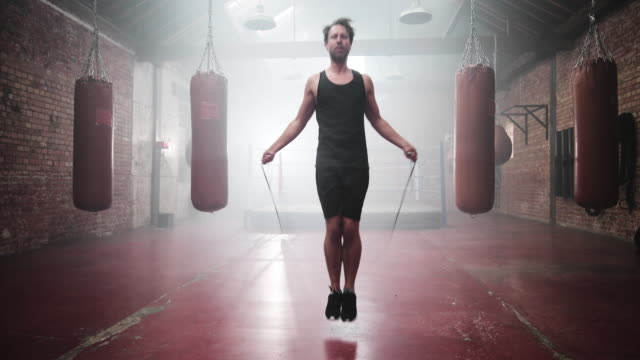 adult male jumping rope in boxing club - military training stock videos & royalty-free footage