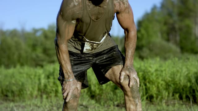 adult male staring intensely during a mud run - superwoman stock videos and b-roll footage