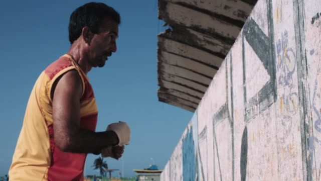 Adult Male training in old stadium in Havana, Cuba