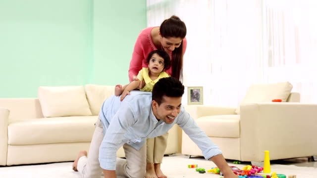 adult man and adult woman playing with their baby at home, delhi, india - indian ethnicity stock videos & royalty-free footage