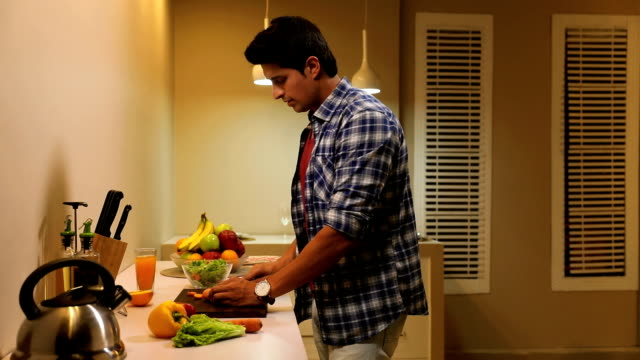 adult man cutting vegetable in the kitchen, delhi, india - fully unbuttoned stock videos & royalty-free footage