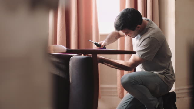 adult man diy at home fixing chair - one mid adult man only stock videos & royalty-free footage