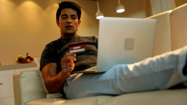 adult man doing online shopping on laptop, delhi, india - home shopping stock videos and b-roll footage