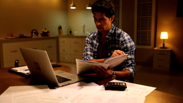 adult man doing online shopping on laptop, delhi, india - only men stock videos & royalty-free footage