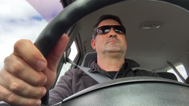 adult man driving a car - 45 49 years video stock e b–roll