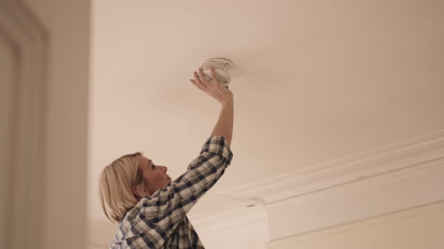 adult man installing smoke alarm in home - installing stock videos & royalty-free footage