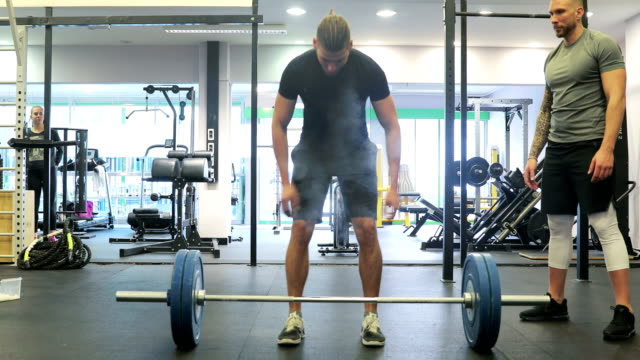 adult man lifting heavy weights in fitness - step aerobics stock videos and b-roll footage