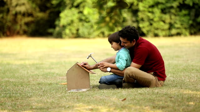 adult man making dummy house with his son, delhi, india - open house stock videos & royalty-free footage