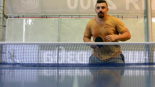 adult man playing, losing and winning table tennis game - table tennis bat stock videos & royalty-free footage