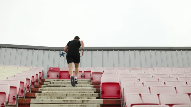 Adult man running up stairs